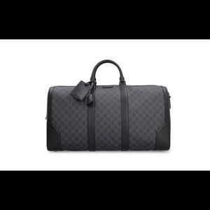 Gucci gg monogram carry on duffel bag.
